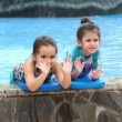 Two happy little girls playing in the pool — Stock Video #47980467
