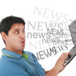 Man in laptop with the word news coming out of the screen — Stock Photo #9584086