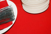 Eating utensilsstack of plates and spoons — Stock Photo