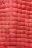Texture of the red old mattress — Stock Photo