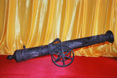 Ancient objects made of iron in the form of little canon in a museum of history — Stock Photo