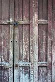 Dřevěné dveře s vybledlé barvy — Stock fotografie