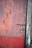Old rusty iron door — Stok fotoğraf