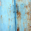 Old and rusty blue iron door — Stock Photo