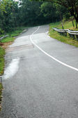 Paved highway uphill and winding — Stock Photo