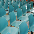 Arrangement of rows of small blue chairs — Photo #13254528