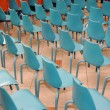 Arrangement of rows of small blue chairs — Foto Stock #13255408