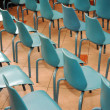 Stock Photo: Arrangement of rows of small blue chairs