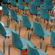Arrangement of rows of small blue chairs — Stockfoto #13263715