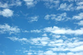 Expanse of clouds in blue sky — Stock Photo