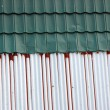 Royalty-Free Stock Photo: Old and new tin roof background