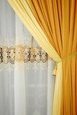Golden yellow silk curtain — Stock Photo