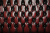 Texture and pattern of red dark leather seat upholstery — Foto Stock