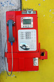 A red public telephone coin at downtown — Stock Photo