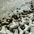 Tetrapods on the beach - Stock Photo