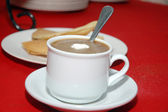 Coffee with creamer — Stock Photo