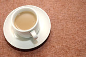 A cup of coffee with creamer — Stock Photo