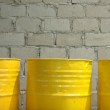 Three yellow steel drum - Stockfoto