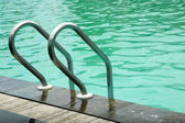 Stainless ladder in the pool — Stock Photo