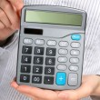 Calculator in hands. — Stock Photo