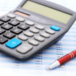 Calculator and pen. — Stock Photo