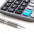 Calculator and pen. — Stock Photo #25290337
