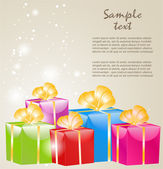 Gift boxes with gold ribbons — Stock Vector