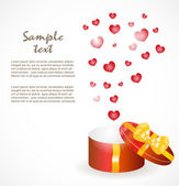 Gift box with gold ribbons — Stock Vector