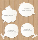 Wooden background with speech bubbles — Stock Vector