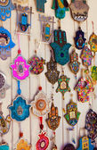 Different kind of remembrances and amulets (hamsa, pomegranate, — Stock Photo