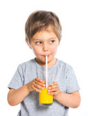 Portrait of little boy drinking orange juice — Stock Photo