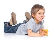 Little boy drinking orange juice — Stock Photo