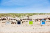 Houses on the beach with blue sky — Stock Photo