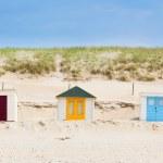 Houses on the beach with blue sky — Stock Photo #13713689