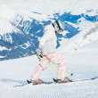 Happy little girl skiing downhill — Stock Photo
