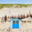 House on the beach with blue sky — Stock Photo #14359757