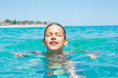 Young girl playing in the sea — Stock Photo