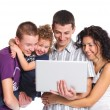 Young parents, with children, on laptop computer — Stock Photo #14677465