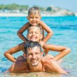 Family playing in the sea — Stock Photo #15301105
