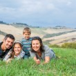 Happy family having fun outdoors in Tuscan — Stock Photo