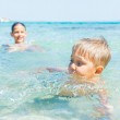 Kids playing in the sea — Stock Photo #15499673