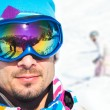 Постер, плакат: Young man with ski goggles