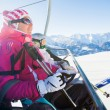 Skiers on a ski-lift — Stock Photo