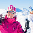 Young womwith skis and ski wear — Stock Photo #15854645