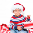 Little boy in Santa's hat with gift box — Stock Photo