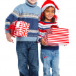 Little kids in Santa's hat with gift box — Stockfoto