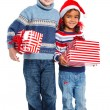 Little kids in Santa's hat with gift box — Stock Photo #16275501