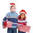 Little kids in Santa's hat with gift box — Stock Photo #16275579