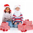 Stock Photo: Little kids in Santa's hat with gift box