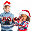Kids in Santa's hat holding a christmas ball - Stock Photo